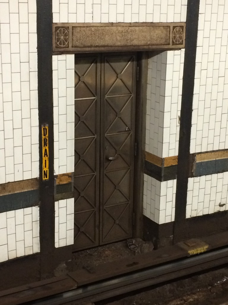Brass door with carved stone lintel at IRT 1-2-3 72nd Street station