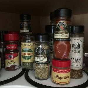 Assorted spices in a kitchen cabinet
